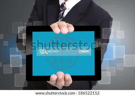 Businessman used hand for hold touch pad  to search internet in studio - stock photo