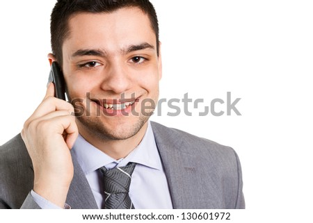 Businessman using a cell phone, close up portrait.