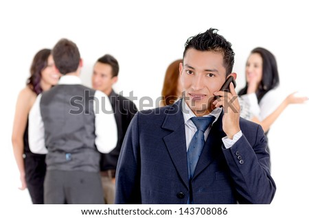 Businessman using a cellphone with peers - stock photo