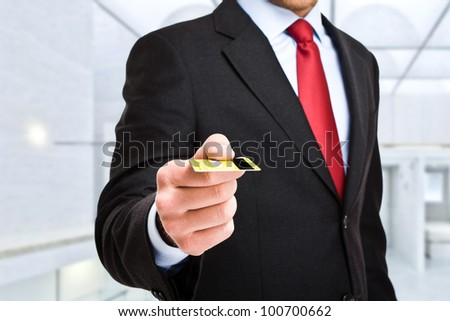 Businessman using a credit card - stock photo