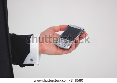 Businessman using a hand held computing device.