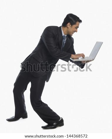 Businessman using a laptop - stock photo