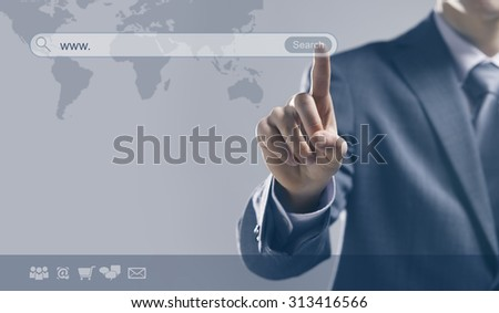 Businessman using a search engine and pressing a search button with world map on background - stock photo