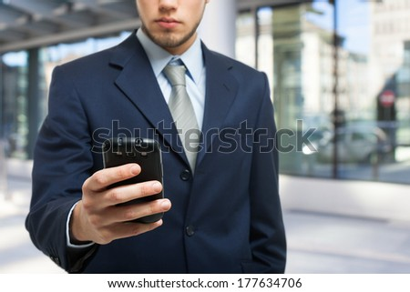 Businessman using a smartphone - stock photo