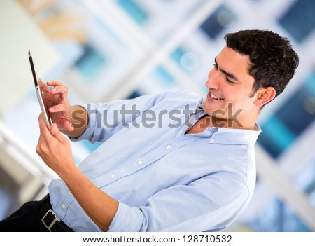 Businessman using a tablet computer at the office - stock photo