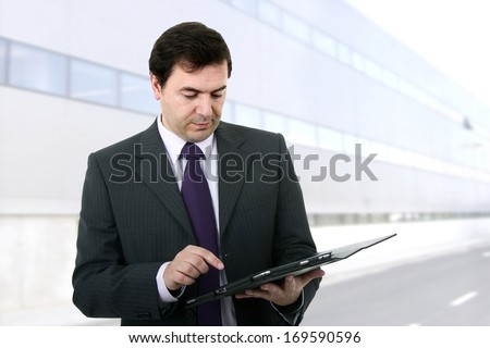 Businessman using a tablet pc on the office - stock photo