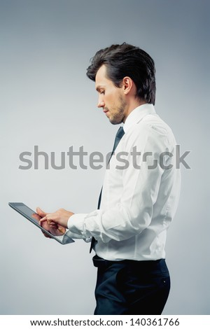 businessman using a touch pad - stock photo