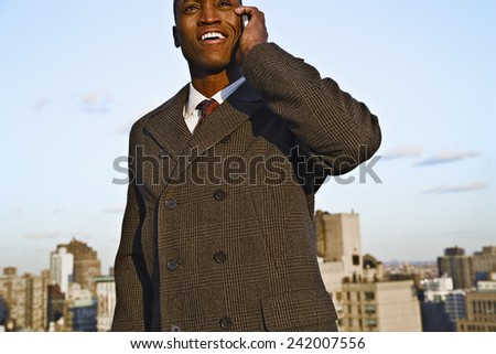 Businessman Using Cell Phone - stock photo