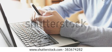 Businessman using digital laptop and mobile phone
