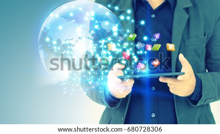 Businessman using digital tablet. Application icons interface on screen. Social media concept