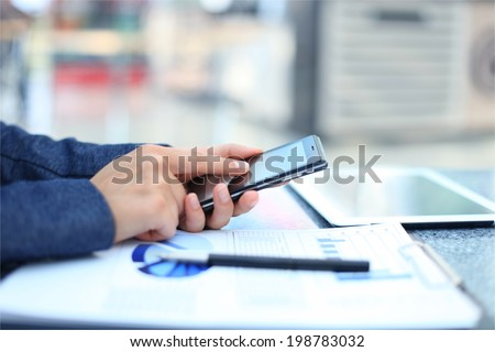 Businessman using digital tablet computer with modern mobile phone - stock photo