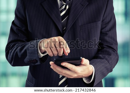 Businessman using digital tablet. Toned photo