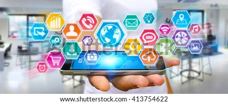 Businessman using digital tactile screen with his mobile phone - stock photo