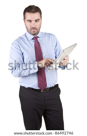 Businessman using electronic tablet over white background - stock photo