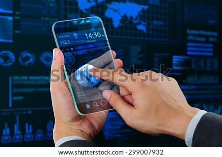 businessman using futuristic mobile device - stock photo