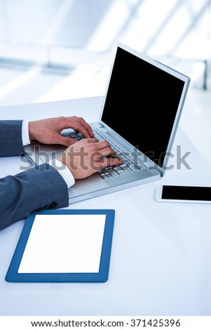 Businessman using his computer in his office