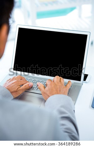 Businessman using his laptop in an office