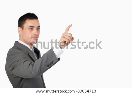 Businessman using invisible touchscreen against a white background