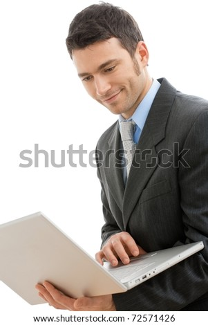 Businessman using laptop computer, standing, smiling. Isolated on white background.? - stock photo