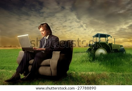 businessman using laptop in the country - stock photo