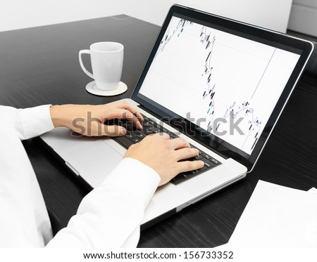 Businessman using laptop in the office - stock photo