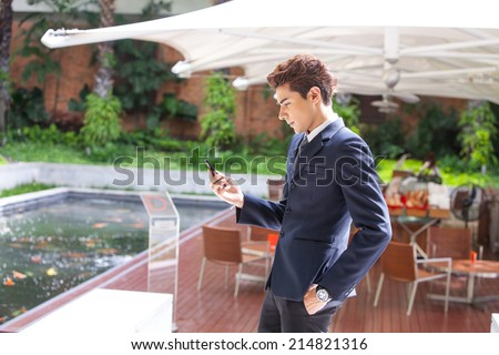 Businessman using mobile phone at the hotel. - stock photo