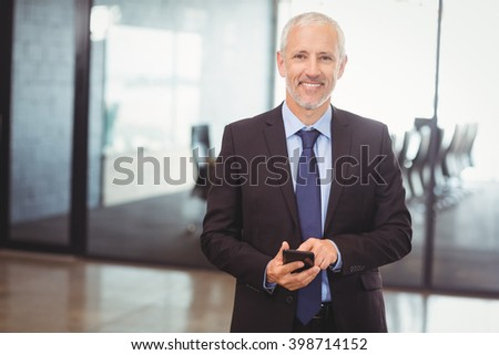 Businessman using mobile phone in the office - stock photo