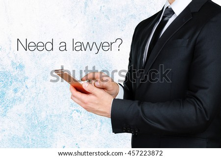 businessman using mobile smart phone near text - Need a lawyer? - stock photo