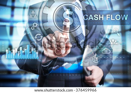 Businessman using modern computer, pressing cash flow button on virtual screen. business, technology and internet concept. - stock photo