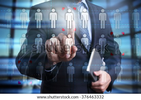Businessman using modern computer, pressing human icon on virtual screen. Human resource, HR, team building, recruitment, headhunting, talent management. - stock photo