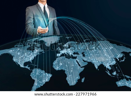 businessman using smart phone connecting to the world - stock photo
