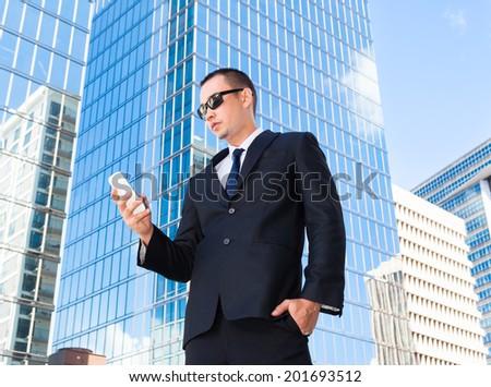 Businessman using smart phone mobile - stock photo