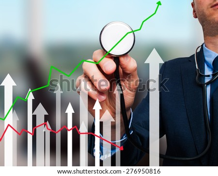 Businessman using stethoscope to diagnose business performance. Business finance, technology concept. Isolated on office. Stock Photo - stock photo