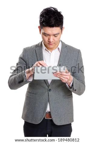 Businessman using tablet - stock photo