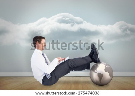 Businessman using tablet against clouds in a room - stock photo