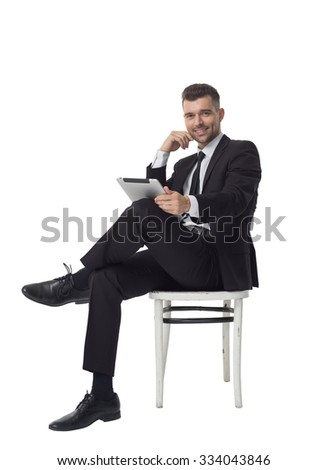 Businessman using tablet computer Full Length Portrait isolated on White Background - stock photo