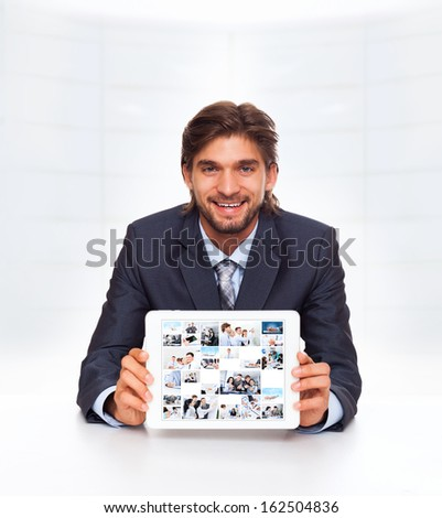 businessman using tablet pad computer communication technology smile, business man desk office show touch screen with businesspeople photo, concept virtual conference meeting