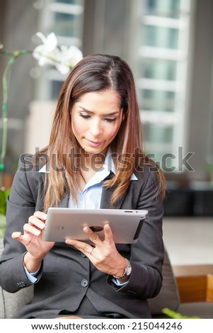 Businessman using tablet PC at the hotel lobby.