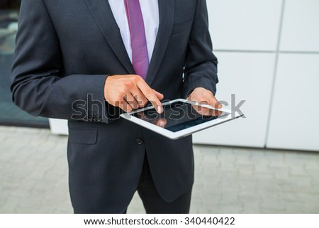 Businessman using tablet pc. Close up - stock photo