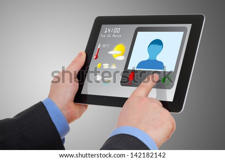 Businessman using tablet to video conference, meet online. - stock photo