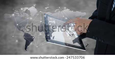 Businessman using tablet with digital visual object, business strategy concept - stock photo