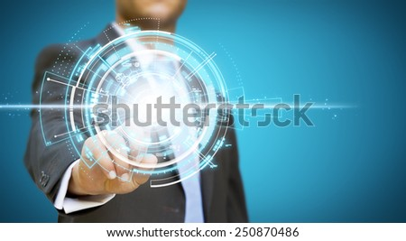 Businessman using tactile interface with his fingers - stock photo