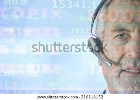 Businessman using telephone headset - stock photo