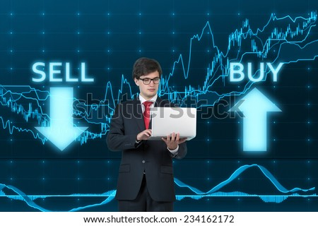 Businessman using the laptop to make a correct choice 'sell' or 'buy'.  - stock photo