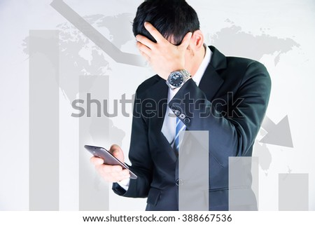 businessman using the phone with graph and world map