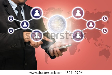 Businessman using the smart phone with the Social media symbol on peach color background with world map,Elements of this image furnished by NASA, Business network concept