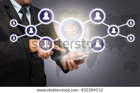 Businessman using the smart phone with the Social media symbol on world map,Elements of this image furnished by NASA, Business network concept