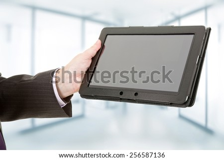 businessman using touch pad, close up shot on tablet pc, at the office