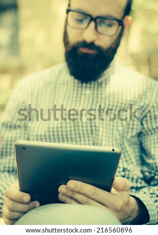 businessman using touch pad of tablet pc - stock photo