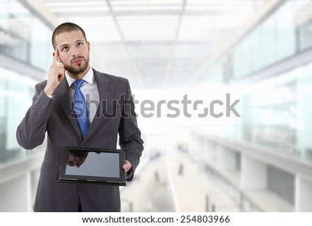 businessman using touch pad of tablet pc at the office - stock photo